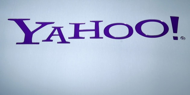A Yahoo logo is pictured in front of a building in Rolle, 30 km (19 miles) east of Geneva, Switzerland on December 12, 2012.   REUTERS/Denis Balibouse/File Photo
