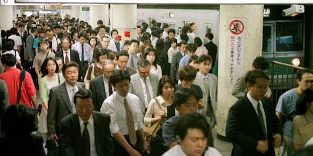 Japanese commuters pack a platform of the Chiyoda-line, one of Tokyo's most popular subway lines, during rush hour at Hibiya station in downtown Tokyo, June 17, 1999.  It has been more than a decade since the Tokyo Metropolitan Transport Bureau proposed a new line that would run a 29-kilometer (18-mile) loop around the city.  The project's construction is now years behind schedule and cost overruns are measured in the hundreds of billions of yen (billions of dollars),so high that they will take four decades to pay off.  (APPhoto/Katsumi Kasahara)