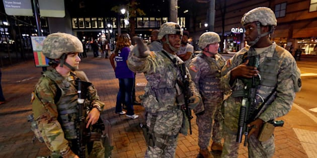 National Guard troops are pictured as they are deployed throughout the city during a protest against the police shooting of Keith Scott, in Charlotte, North Carolina, U.S. September 22, 2016. REUTERS/Jason Miczek