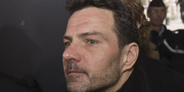 Jerome Kerviel leaves Paris cour house in Paris, Monday, March 21, 2016. French judicial officials are considering whether to order a new trial for former trader Jerome Kerviel, who is protesting his conviction to three years in prison for defrauding bank Societe Generale. (AP Photo/Michel Euler)