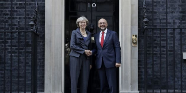 British Prime Minister Theresa May and the President of the European Parliament Martin Schulz perform a posed handshake for the media before their talks at 10 Downing Street in London, Thursday, Sept. 22, 2016. (AP Photo/Matt Dunham)