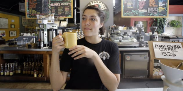 Barista Eviana Dan drinks a cup of coffee at Millcreek Coffee Roasters during National Coffee Day, Tuesday, Sept. 29, 2015, in Salt Lake City. (AP Photo/Rick Bowmer)
