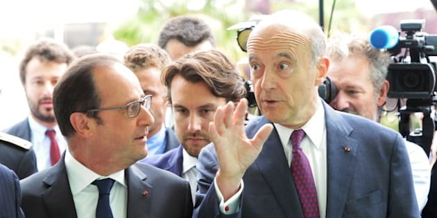 French President Francois Hollande (L) arrives with mayor of Bordeaux Alain Juppe to attend the International Wine and Spirits fair Vinexpo on June 14, 2015 in Bordeaux, southwestern France. AFP PHOTO / MEHDI FEDOUACH        (Photo credit should read MEHDI FEDOUACH/AFP/Getty Images)