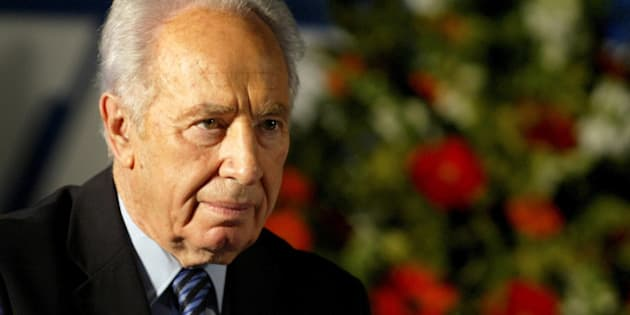 Labour Party leader Shimon Peres attends his party's conference in Tel Aviv, December 12, 2004. REUTERS/Nir Elias/ Files