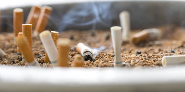 cigarette butts on focus of macro in sand bin