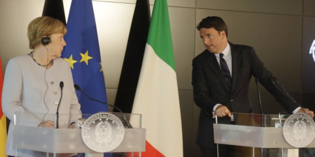 Italian Premier Matteo Renzi, right, and German Chancellor Angela Merkel meet the media during a news conference following their bilateral meeting, in Maranello, Italy, Wednesday, Aug. 31, 2016. (AP Photo/Luca Bruno)