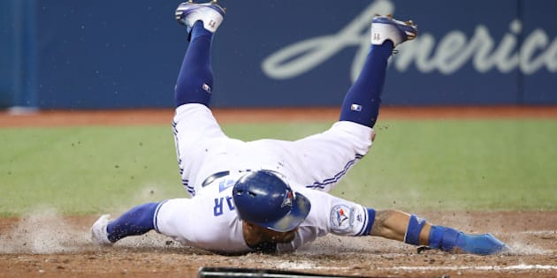TORONTO, CANADA - SEPTEMBER 27: Kevin Pillar #11 of the Toronto Blue Jays slides across home plate to score a run on an RBI double by Ezequiel Carrera #3 in the fifth inning during MLB game action against the Baltimore Orioles on September 27, 2016 at Rogers Centre in Toronto, Ontario, Canada. (Photo by Tom Szczerbowski/Getty Images)