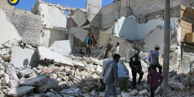 "In this photo provided by the Syrian Civil Defense group known as the White Helmets, members of the Civil Defense group  and residents inspect damaged buildings after airstrikes hit the Bustan al-Qasr neighborhood in Aleppo, Syria, Sunday, Sept. 25, 2016. A broad coalition of Syrian rebels denounced international negotiations for peace as ""meaningless"" on Sunday, as the U.N. Security Council prepared to convene an emergency meeting about the spiraling violence in Syria. (Syrian Civil Defense White Helmets via AP)"