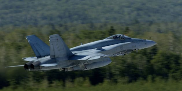A CF-18 takes off from the Canadian Air Force base in Bagotville, Quebec. The Bagotville base is currently serving as Canada's ready base that can respond to terrorist threats and attacks throughout Canada in a matter of minutes with heavily equipped F-18's. (Photo by Lucas Oleniuk/Toronto Star via Getty Images)