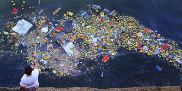 A man holds a fishing rod near a gyre of floating trash at Beirut, Lebanon's coastline with the Mediterranean Sea on Thursday, Sept. 29, 2016. (AP Photo/Hassan Ammar)