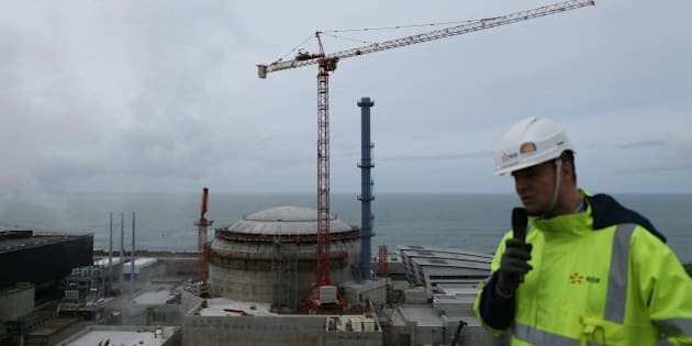 Director of the construction site of the third European generation Pressurized Water Reactor (EPR) Antoine Menager talks in front of the construction site of the European Pressurised Reactor project (EPR) in Flamanville, northwestern France on March 30, 2016. The EPR nuclear reactor is being built by Areva and is due to be operated by French energy group EDF. / AFP / CHARLY TRIBALLEAU        (Photo credit should read CHARLY TRIBALLEAU/AFP/Getty Images)