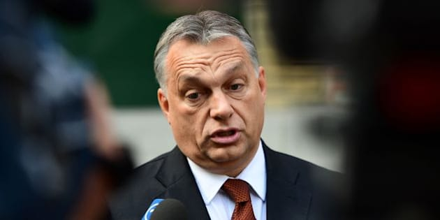Hungarian Prime Minister Viktor Orban answers to the journalists in front of a polling station at a school in Budapest, on October 2, 2016.  Hungarians vote in a referendum on taking migrants as part of an EU-wide mandatory quota scheme, a plan rejected by right-wing Prime Minister Viktor Orban. / AFP / ATTILA KISBENEDEK        (Photo credit should read ATTILA KISBENEDEK/AFP/Getty Images)