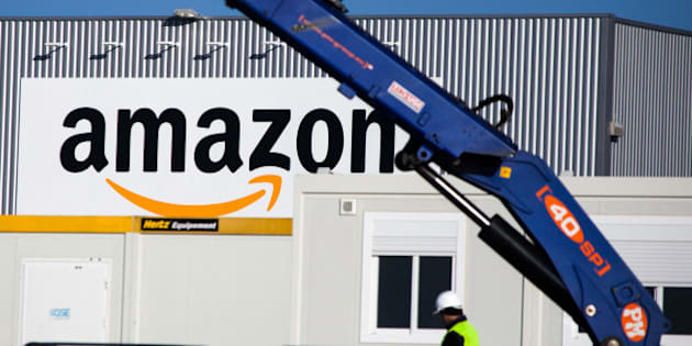 A man works at the new logistics center of online merchant Amazon in Lauwin-Planque, northern France,  Thursday, Sept. 19, 2013. Amazon France plans to create 2500 jobs by 2015 in this center. (AP Photo/Michel Spingler)