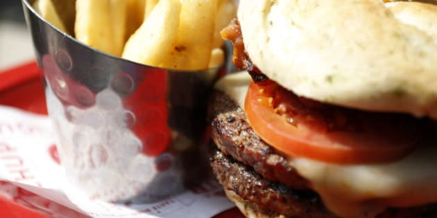 """A meal of a """"Monster""""-sized A.1. Peppercorn burger, and Bottomless Steak Fries is seen at a Red Robin restaurant in Foxboro, Massachusetts July 30, 2014. If combined with a Monster Salted Caramel Milkshake, the dish was listed as the single unhealthiest meal to appear on the non-profit Center for Science in the Public Interest's (CSPI) Xtreme Eating Awards for 2014. The meal contains a grand total of 3,540 calories, three-and-a-half days' saturated fat (69 grams), and four days' worth of sodium (6,280 mg), according to the CSPI.   REUTERS/Dominick Reuter  (UNITED STATES - Tags: FOOD SOCIETY HEALTH)"""