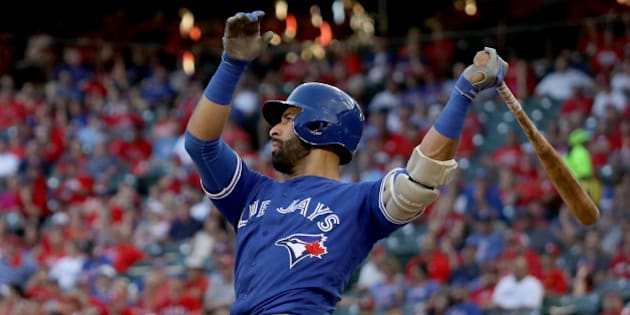 ARLINGTON, TX - OCTOBER 06:  Jose Bautista #19 of the Toronto Blue Jays hits a three run home run to left field agianst Jake Diekman #41 of the Texas Rangers during the ninth inning in game one of the American League Divison Series at Globe Life Park in Arlington on October 6, 2016 in Arlington, Texas.  (Photo by Ronald Martinez/Getty Images)