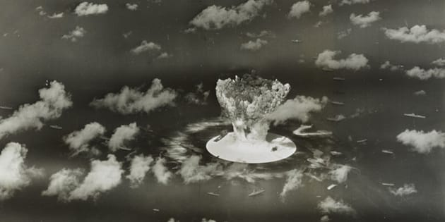 A mushroom cloud rises with ships below during Operation Crossroads nuclear weapons test on Bikini Atoll, Marshall Islands in this 1946 handout provided by the U.S. Library of Congress.  The United States said on April 25, 2014, it was examining lawsuits filed by the Marshall Islands against it and eight other nuclear-armed countries that accuse them of failing in their obligation to negotiate nuclear disarmament.  REUTERS/U.S. Library of Congress/Handout via Reuters   (MARSHALL ISLANDS - Tags: POLITICS MILITARY CONFLICT) ATTENTION EDITORS - FOR EDITORIAL USE ONLY. NOT FOR SALE FOR MARKETING OR ADVERTISING CAMPAIGNS. THIS PICTURE WAS PROVIDED BY A THIRD PARTY. REUTERS IS UNABLE TO INDEPENDENTLY VERIFY THE AUTHENTICITY, CONTENT, LOCATION OR DATE OF THIS IMAGE. THIS PICTURE IS DISTRIBUTED EXACTLY AS RECEIVED BY REUTERS, AS A SERVICE TO CLIENTS