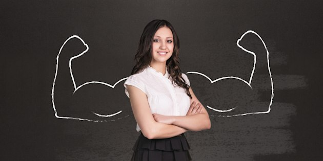 Business woman with drawn powerful hands. Black chalkboard background.
