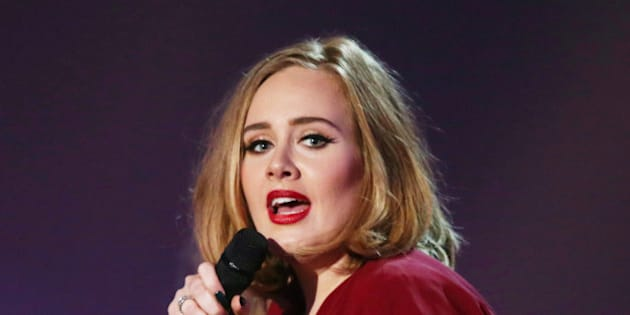 """FILE - In this Feb. 24, 2016 file photo shows Adele onstage at the Brit Awards 2016 at the 02 Arena in London. Adele told the crowd at her show in New York City on Sept. 20, 2016, that news of Brad Pitt and Angelina Jolie's divorce """"feels like the end of an era."""" (Photo by Joel Ryan/Invision/AP, File)"""
