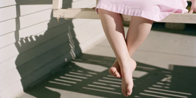 Girl Sitting on Porch Swing