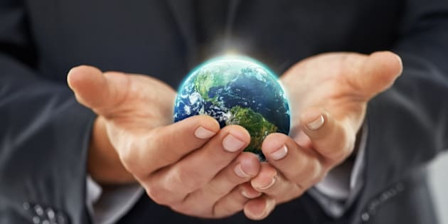 Cropped image of a businessman holding a globe in his cupped handshttp://195.154.178.81/DATA/i_collage/pi/shoots/783268.jpg
