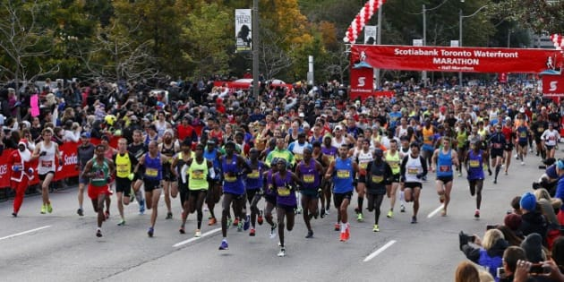 TORONTO, ON - October 18, 2015 - The top runners leave the start line during the Toronto Waterfront Marathon in Toronto, Ontario, October 18, 2015 Todd Korol/Toronto Star        (Todd Korol/Toronto Star via Getty Images)