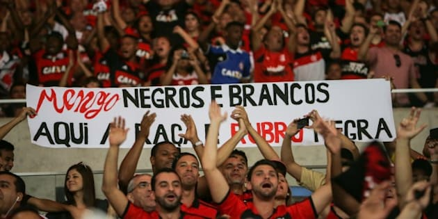 Flamengo's fans hold a placard against racism before their Brazilian championship match against Gremio, at Maracana stadium in Rio de Janeiro, Brazil, on September 6, 2014.  AFP PHOTO / YASUYOSHI CHIBA        (Photo credit should read YASUYOSHI CHIBA/AFP/Getty Images)