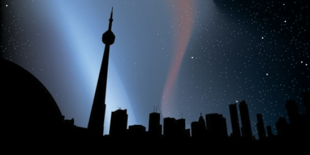Skyline silhouette of downtown Toronto, Canada, at night.