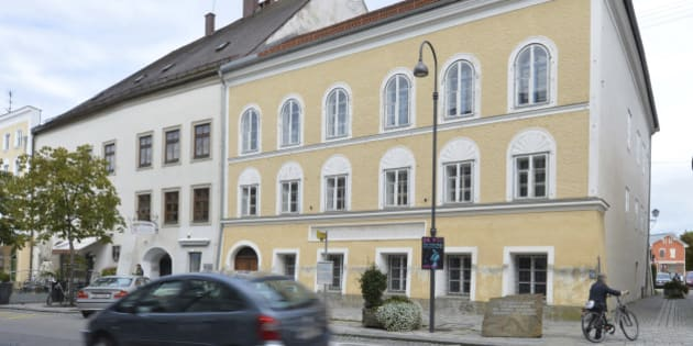FILE - This Sept. 27, 2012 file picture shows an exterior view of Adolf Hitler's birth house, front, in Braunau am Inn, Austria. Austria's government said on Monday, Oct. 17, 2016 that it plans to tear down the house where Hitler was born and replace it with a new building. (AP Photo / Kerstin Joensson, File)