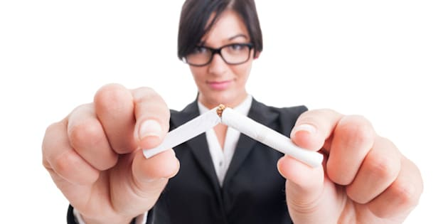 Business woman breaking a cigarette in half. Stop or quit smoking concept.