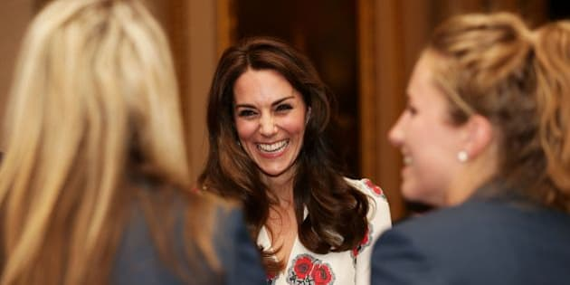 Britain's Catherine, Duchess of Cambridge, meets members of the British Olympic womens hockey team, as she meets athletes during a reception for Team GB's Olympic and Paralympic athletes, hosted by Britain's Queen Elizabeth II, at Buckingham Palace in central London on October 18, 2016. Britain's stars of this year's Olympic and Paralympic Games in Rio attended an 'amazing' reception at Buckingham Palace -- the official London home of Queen Elizabeth II -- on Tuesday. / AFP / POOL / Yui Mok        (Photo credit should read YUI MOK/AFP/Getty Images)