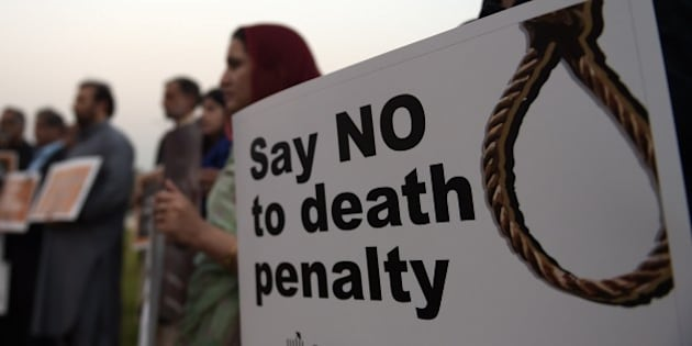 Activists from the Human Rights Commission of Pakistan (HRCP) carry placards during a demonstration to mark International Day Against the Death Penalty in Islamabad on October 10, 2015. Pakistan lifted a moratorium on executions in December 2014 after Taliban gunmen massacred more than 150 people at a school, at first only in terror-related offences, but later for all capital cases. Around 200 people have been executed since the moratorium was lifted, and no mercy petitions to the president have been accepted. AFP PHOTO / Aamir QURESHI        (Photo credit should read AAMIR QURESHI/AFP/Getty Images)