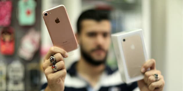 A Palestinian man holds Apple's new iPhone 7 at a mobile phone store in Gaza City on September 22, 2016. Apple's new iPhone 7 is selling well in the Gaza Strip despite inflated prices. (Photo by Majdi Fathi/NurPhoto via Getty Images)