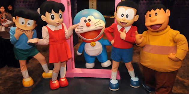 Doraemon (C), Japan's robot cat from the future, and the other characters of the popular manga strips created in 1969, pose for photos during a pre-show press conference in Taipei on December 3, 2012.  The show, about Doraemon and the rest of Japanese cartoon characters in the manga strips, will be held in Taipei from December 29 through April 7, 2013. The cartoon exploits of the electronic feline have captivated children across Asia.    AFP PHOTO / Mandy CHENG        (Photo credit should read Mandy Cheng/AFP/Getty Images)