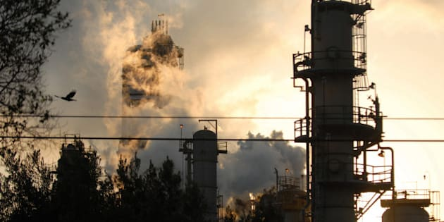 UNITED STATES - SEPTEMBER 18:  An Exxon Mobil refinery in silhouetted against the sky at dusk in Torrance, California, U.S., on Tuesday, September 18, 2007. California, the most-populous U.S. state, emitted the equivalent of 436.1 million metric tons of carbon dioxide in 1990, according to a draft estimate of global warming pollution from the state's air-quality regulator. Heads of state and other top officials from more than 150 countries will attend the largest meeting ever of world leaders on climate change at the United Nations on September 24, 2007, in New York.  (Photo by Jamie Rector/Bloomberg via Getty Images)