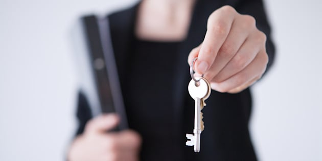 Person handing over house keys.