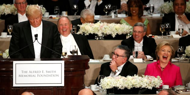 Democratic U.S. presidential nominee Hillary Clinton (R) laughs at a joke by Republican U.S. presidential nominee Donald Trump (L) at the Alfred E. Smith Memorial Foundation dinner in New York, U.S. October 20, 2016. REUTERS/Jonathan Ernst