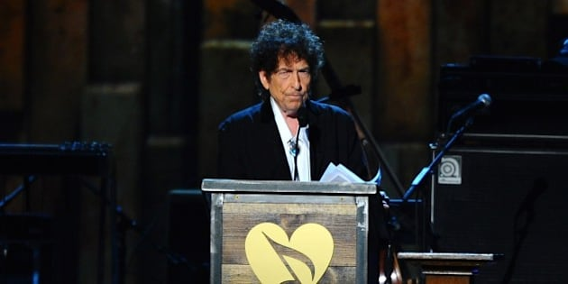 Bob Dylan accepts the 2015 MusiCares Person of the Year award on stage at the 2015 MusiCares Person of the Year show at the Los Angeles Convention Center on Friday, Feb. 6, 2015, in Los Angeles. (Photo by Vince Bucci/Invision/AP)