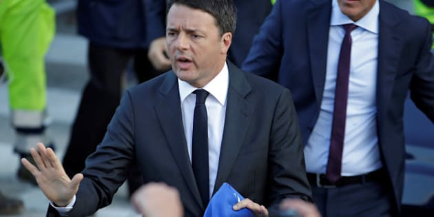 After an earthquake in central Italy, Italian Prime Minister Matteo Renzi gestures before leaving Camerino, Italy October 27, 2016. REUTERS/Max Rossi