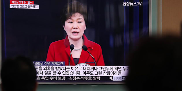 People watch a television screen showing an image of Park Geun Hye, South Korea's president, during a news broadcast at Seoul Station in Seoul, South Korea, on Monday, Oct. 31, 2016. As Park's popularity plummets, members of her own party are publicly demanding action to staunch the bleeding from an influence-peddling scandal. Photographer: SeongJoon Cho/Bloomberg via Getty Images