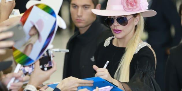 Lady Gaga gives her autographs to fans upon her arrival at Narita international airport in Narita, east of Tokyo, Tuesday, Nov. 1, 2016. (AP Photo/Shizuo Kambayashi)