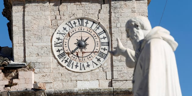 The clock of the damaged town hall tower is seen in the ancient city of Norcia following an earthquake in central Italy, October 31, 2016. REUTERS/Remo Casilli