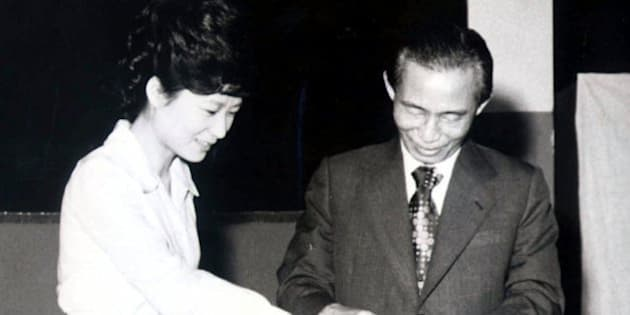 Former South Korean President Park Chung-hee, right, and his daughter Park Geun-hye cast ballots in Seoul, South Korea, in this 1977  photo. Park Geun-Hye, now one of 16 female legislators in the 273-member National Assembly, has embarked on a successful political career, motivated by a desire to rebuild the reputation of the country's most controversial president. (AP Photo/Yonhap)