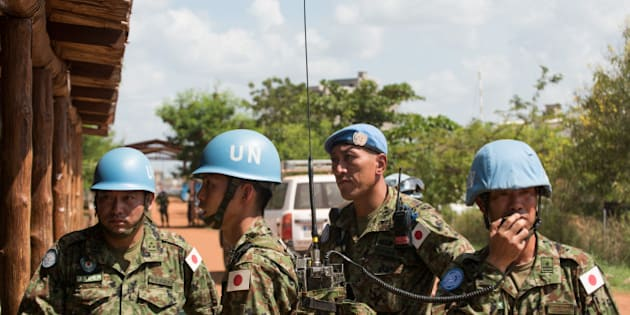 Japanese United Nations Mission in the Republic of South Sudan (UNMISS) troops wait for the arrival of the Japanese minister of defence at the UNMISS base in Tomping Juba on October 8, 2016.   Japanese Minister of Defence Tomomi Inada is to hold talks with the South Sudan Ministry of Defence regarding Japan sending peace keepers to South Sudan in an expanding role of more engagement in peace building efforts, and bilateral cooperation.  / AFP / Charles Atiki Lomodong        (Photo credit should read CHARLES ATIKI LOMODONG/AFP/Getty Images)
