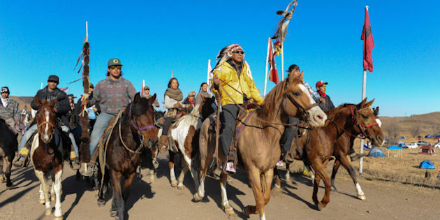 Horse riders from the Bigfoot Riders, Dakota 38 Riders, Spirit Riders and the Bigfoot Youth Riders arrive at the Oceti Sakowin camp during a protest against the Dakota Access pipeline near the Standing Rock Indian Reservation near Cannon Ball, North Dakota November 5, 2016. REUTERS/Stephanie Keith
