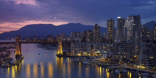 Yaletown and the Burrard Bridge in False Creek in the city of Vancouver, British Columbia in Canada.