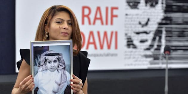 TOPSHOT - Ensaf Haidar holds a picture of her husband Raif Badawi after accepting the European Parliament's Sakharov human rights prize on behalf of her husband, at the European Parliament in Strasbourg, eastern France, on December 16, 2015.  Raif Badawi is a Saudi Arabian blogger and author of a website, detained since 2012 on the charge of breaking Saudi technology laws and insulting religious figures.  / AFP / PATRICK HERTZOG        (Photo credit should read PATRICK HERTZOG/AFP/Getty Images)