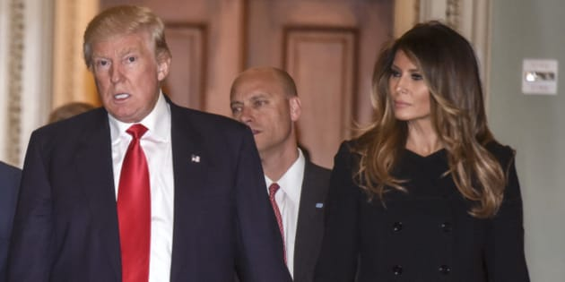 WASHINGTON, DC - NOVEMBER 10: President Elect Donald Trump, center, walks through the halls of th U.S. Capitol for a meeting with Senate Majority Leader Mitch McConnell, left, (R-KY) on November, 10, 2016 in Washington, DC.  Accompanying him are his wife, Melania, right, and Vice President Elect Mike Pence, second left. (Photo by Bill O'Leary/The Washington Post via Getty Images)