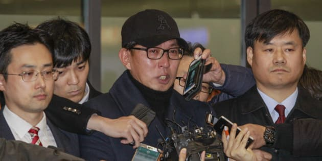 Cha Eun Taek of Choi Soon Sil confident, stand pose after arrives entry gate at international airport in Incheon, South Korea, on November 8, 2016. The Ministry of Culture, Sports and Tourism admitted that it granted favors to Cha Eun-taek, a TV commercials director and confidant of Choi Soon-sil, in funding and supporting Chas musical One Day, which President Park Geun-hye attended in 2014 and gave a rave review. (Photo by Seung-il Ryu/NurPhoto via Getty Images)