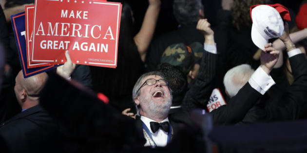 Supporters of Republican presidential candidate Donald Trump react as they watch the election results during Trump's election night rally, Tuesday, Nov. 8, 2016, in New York. (AP Photo/John Locher)