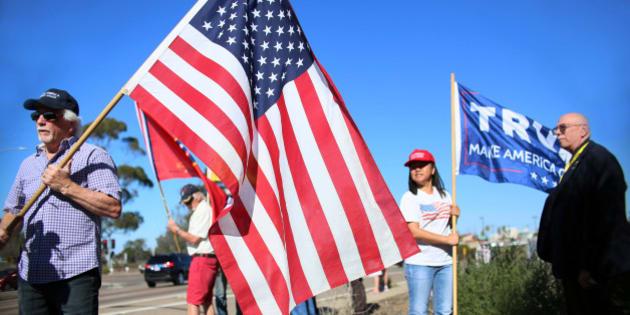 Demonstrators hold signs in support of President elect Donald Trump outside of Camp Pendleton in Oceanside, California, U.S. November 11, 2016.  REUTERS/Sandy Huffaker